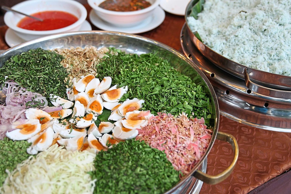 In some northern states, up to 40 kinds of ulam are used to make up nasi kerabu. — Filepic