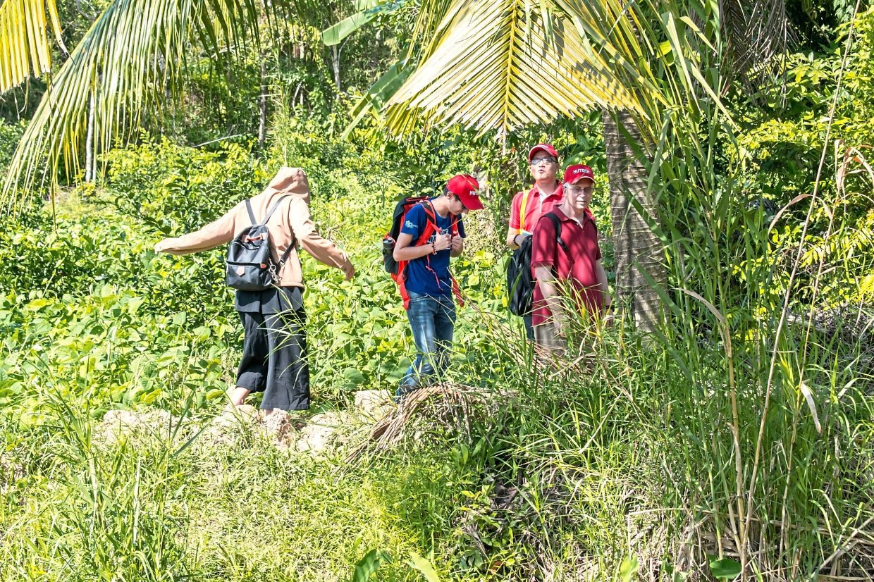 Olmedo (extreme right) embarked on field research in Vietnam, Cambodia and Malaysia to study the various types of ulam in the region, in preparation for the launch of the Ulam School. — ERIC OLMEDO