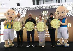 Upin and Ipin etched in gold coins