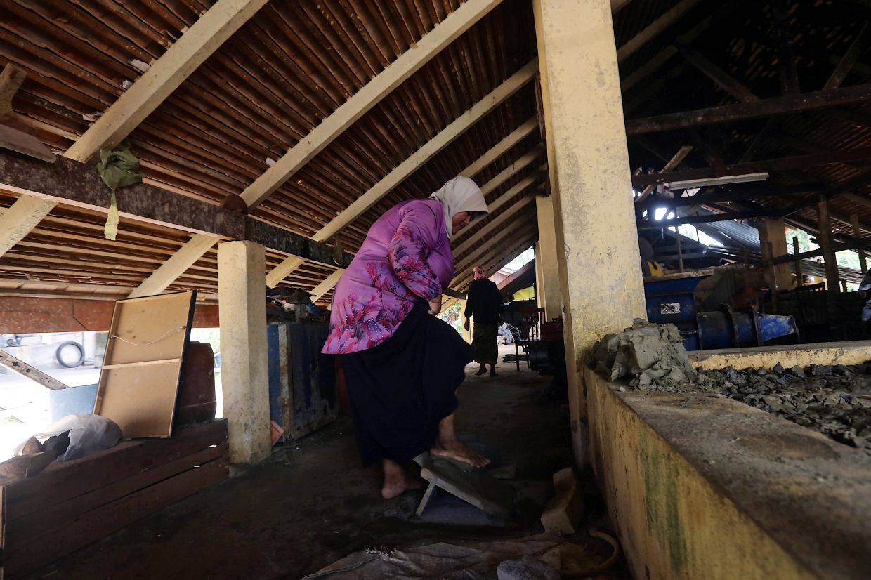 'I'm not doing this just for myself but to preserve the singhora roof heritage, as well as offer opportunities to the local community to generate a side income,' says Noraini. Photo: Bernama