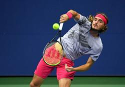 Tsitsipas grinds down Cressy to reach third round