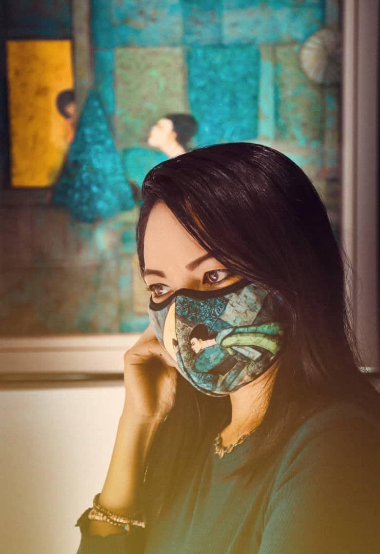 A visitor wearing a face mask featuring a 1980s-era batik work ('Lullaby') from Chuah Thean Teng, who is regarded as the Father of Batik Painting.
