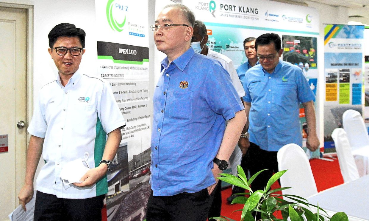 Looking forward: Low (third from left) accompanying Transport Minister Datuk Seri Dr Wee Ka Siong (centre) and Port Klang Authority chairman Datuk Chong Sin Woon (left) on their recent visit to PKFZ.