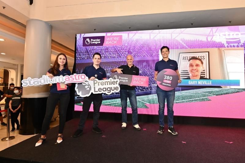 (From right) Astro head of sports C.K. Lee, Astro group chief operating officer and CEO, TV Euan Smith, and Astro presenters Adam Carruthers and Reem Shahwa at the launch of Astro's EPL packages and goodies for the 2020/21 season. Former Man Utd and England right-back makes a special virtual appearance (background).