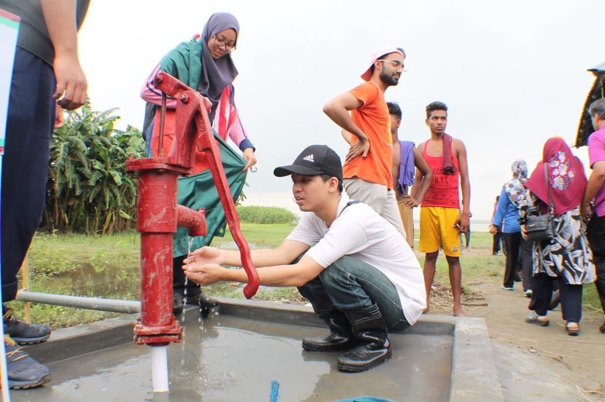 A UoC MBBS student testing the tube well that was recently built as part of their mission in Bangladesh in 2018.