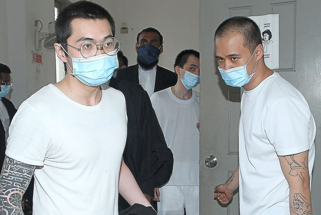 Free men: (From left) Yip, Woon and Gan leaving the High Court after they were acquitted.
