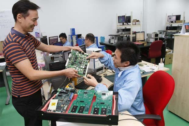"""They (China) need to source externally RF testers and the intellectual properties that can help them to produce their RF testers. ""Aemulus is one of the few companies in Asia that own the intellectual properties to design and develop RF testers, "" NG said.(File pic shows work at the Aemulus factory)"