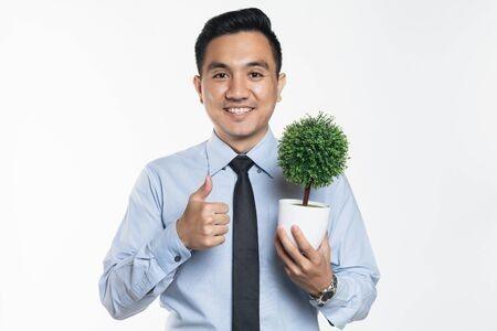 A potted plant can brighten up your workspace.