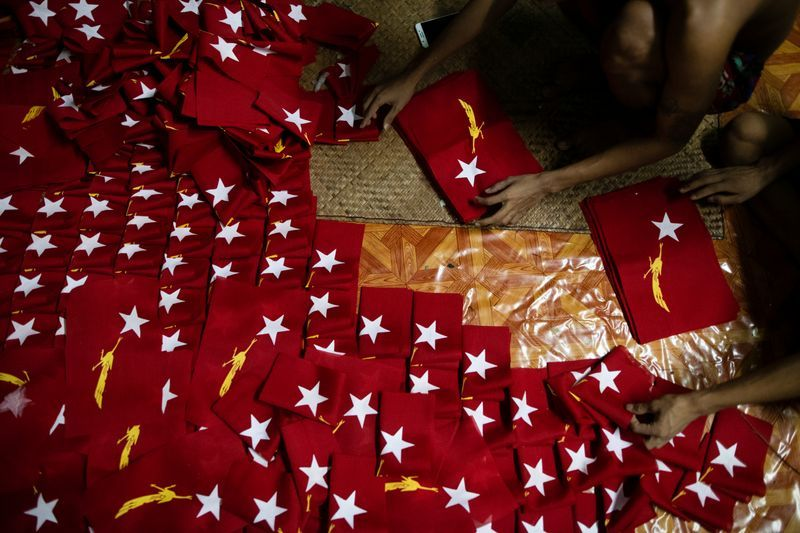 Workers prepare flags with the logo of Aung San Suu Kyis National League for Democracy NLD party at a printing house as election campaigns kick-off in Yangon Myanmar September 7 2020. Picture taken September 7 2020. REUTERSShwe Paw Mya Tin