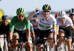 Bennett gets first Tour de France stage win, Roglic retains overall lead