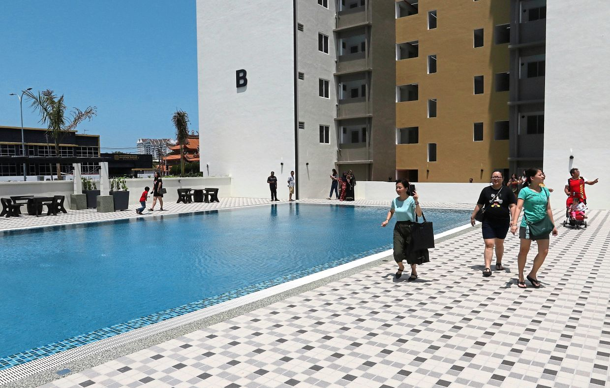Unit owners looking at the pool at affordable housing scheme The Park@Jalan Mak Mandin, Butterworth. The state is planning to increase the number of affordable homes. — Filepic