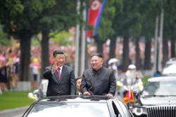 China's Xi hails ties with N.Korea in message to Kim Jong-un