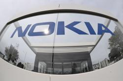 Once a handset superpower, Nokia still commands a potent weapon
