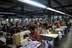 Cambodia raises 2021's minimum wage for garment industry despite Covid-19 impact