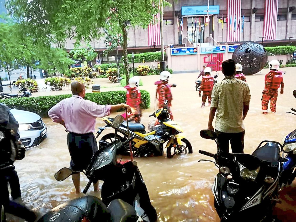 Many motorcycles and cars were trapped in the floods.