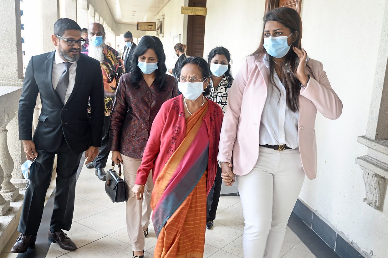 No intervention:  Meeriam Rosaline (second from left) with Ramesh and her family at the Kuala Lumpur Court Complex.