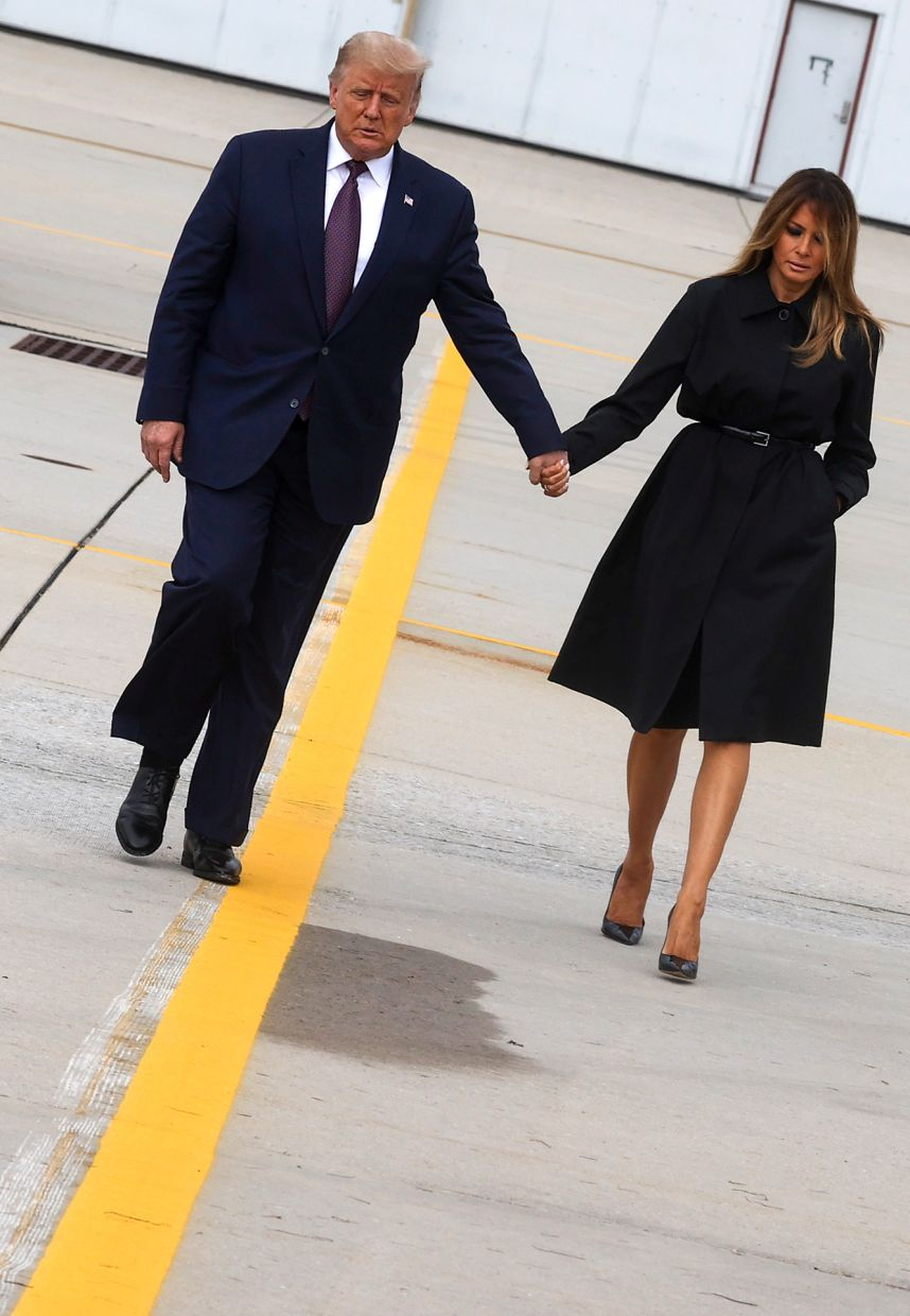 President Trump and Melania walk to board Air Force One to return to Washington after participating in a September 11 remembrance ceremony at the Flight 93 National Memorial.  —  Reuters