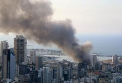 Smoke from Beirut port remnants of Thursday fire, 'no danger to city' - source