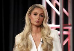 Paris Hilton claims her dumb-blonde persona was just an act