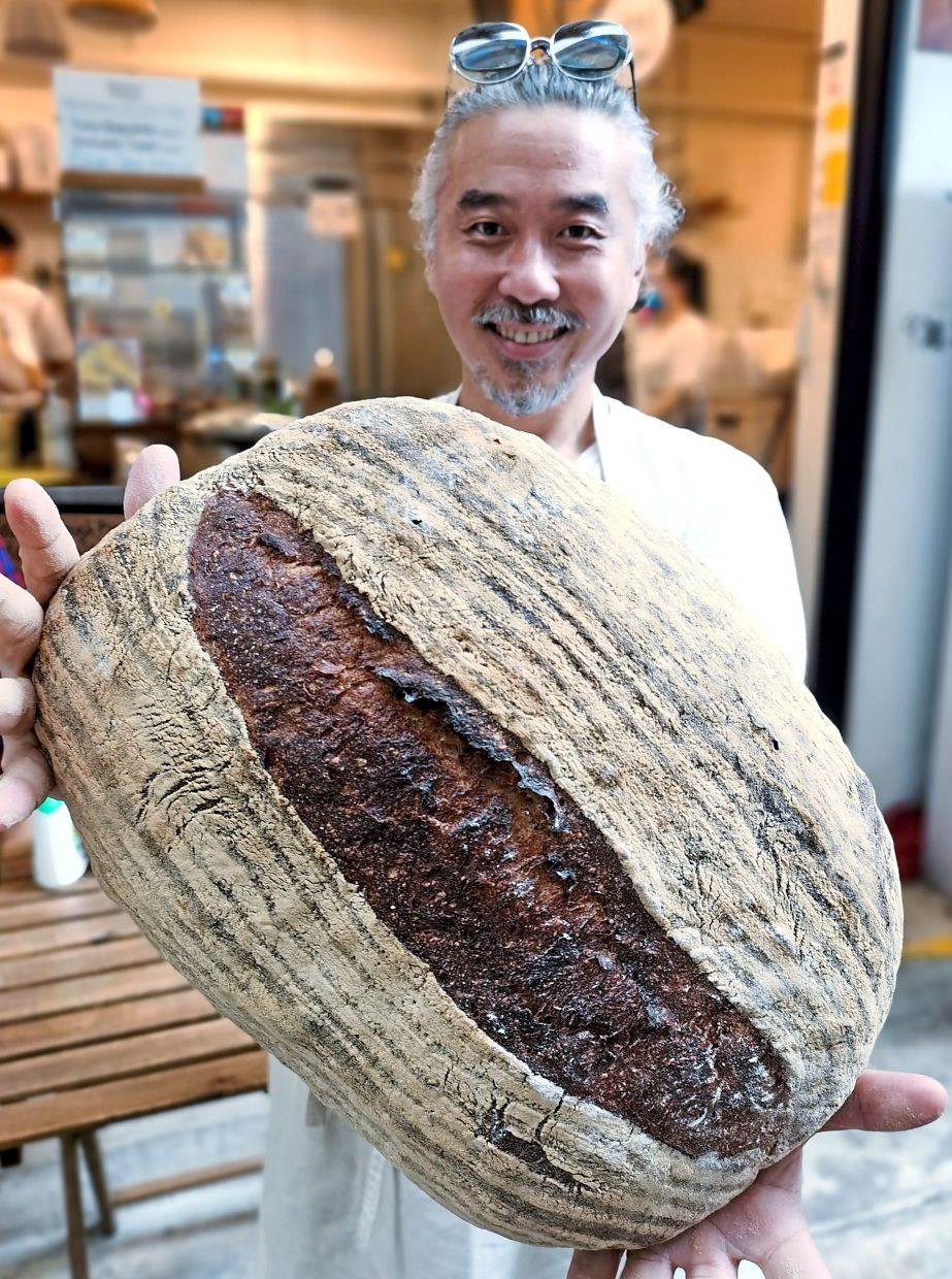 Lee with his giant sourdough bread.