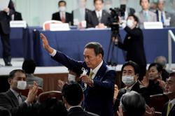 Japan's Suga: Want to try to accomplish constitutional reform
