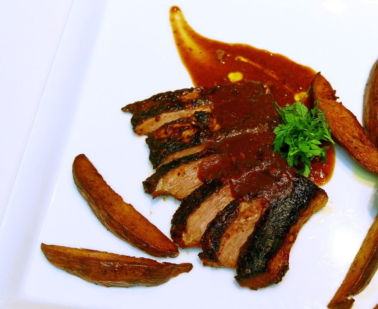The matambre with balsamic glaze and potato wedges. — Photos: CHAN TAK KONG/The Star