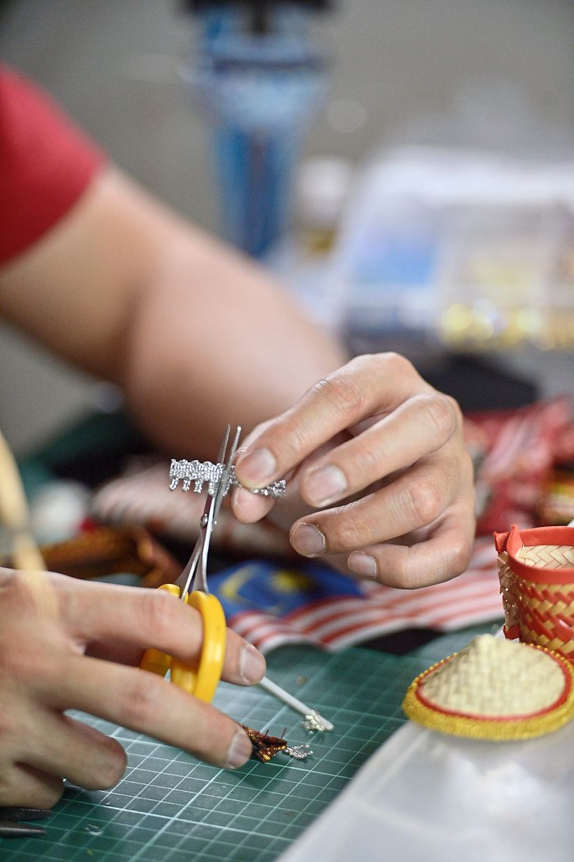 It requires time and a steady hand to create the traditional miniature clothing and accessories.