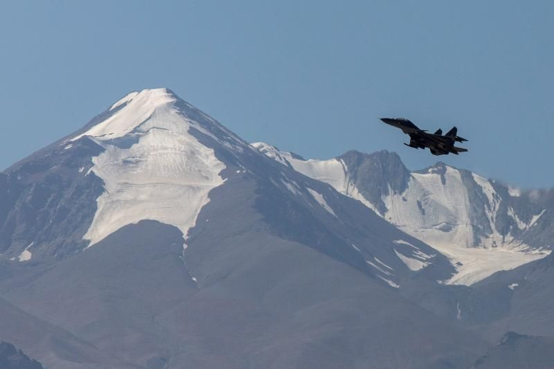 An Indian fighter plane flies over a mountain range in Leh, in the Ladakh region, Sept 14, 2020. - Reuters