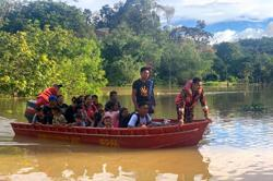 Evacuations commence, schools close as floods hit Sarawak