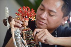 Malaysia Day Special: Dolls transformed into Bornean beauties by Malaysian