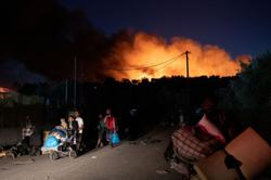 Greek police detain five people over fire in Moria camp