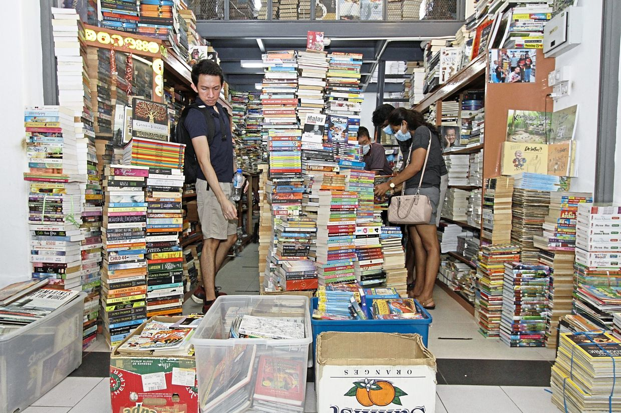 Shoppers searching for good reads at a store at Chowrasta Market.
