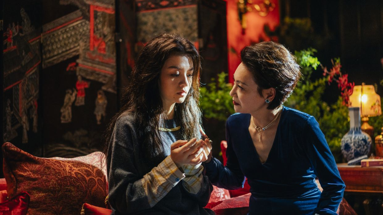 Villain Lotus (right, played by Kara Hui) makes Jing Mo (Jessie Li) an offer she can't refuse.