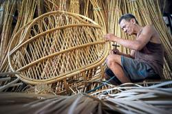 Holding a lonely fort for rattan-weaving