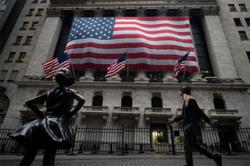 Stocks end higher on growing hopes Fed will stay accommodative