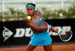 After early exits in New York, Gauff gets first win on clay