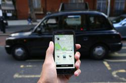 Uber tried to conceal driver photo fraud, London cabbies say