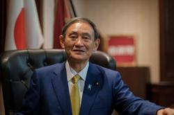 Japan's Suga pledges to beef up alliance with U.S. in first news conference