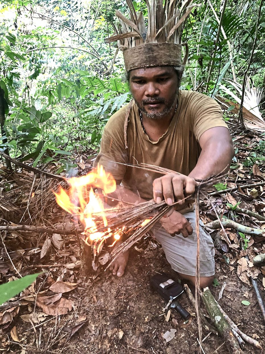 A Semai Orang Asli tribesman demonstrates how to safely build a fire to cook food, keep warm and scare away wild animals, as part of the jungle survival skills that visitors can learn at JSGM. Photo: The Star/Ming Teoh
