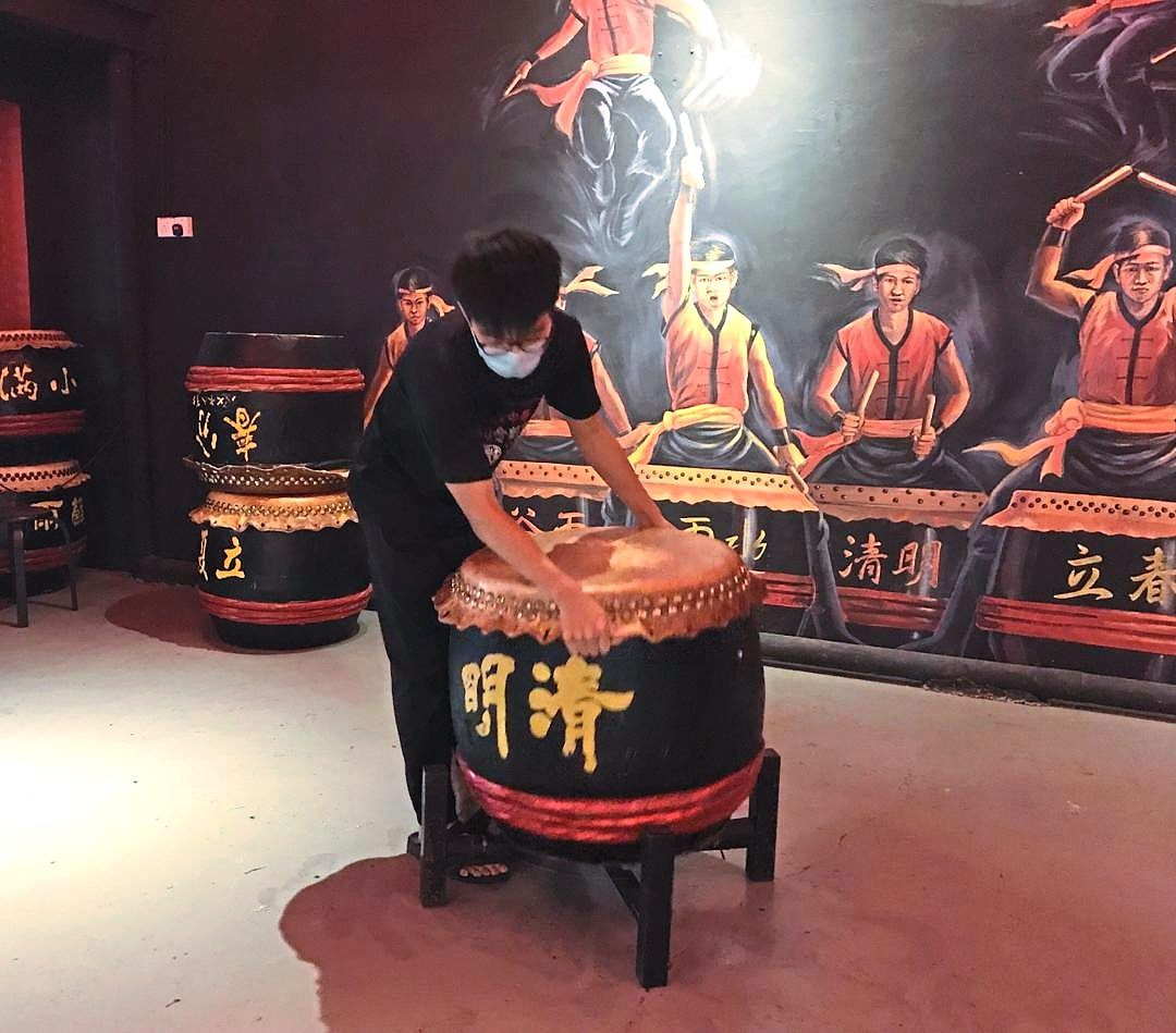 24 Festive Drums Museum staff Lee Chun Wei keeping the premises clean despite it being temporarily closed.