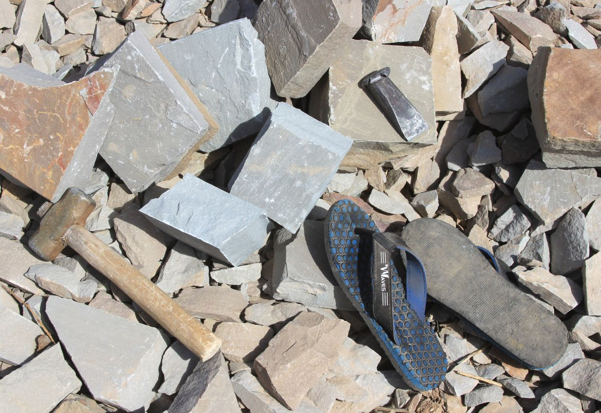 A child's tools and shoes in a quarry in the Indian province of Rajasthan.