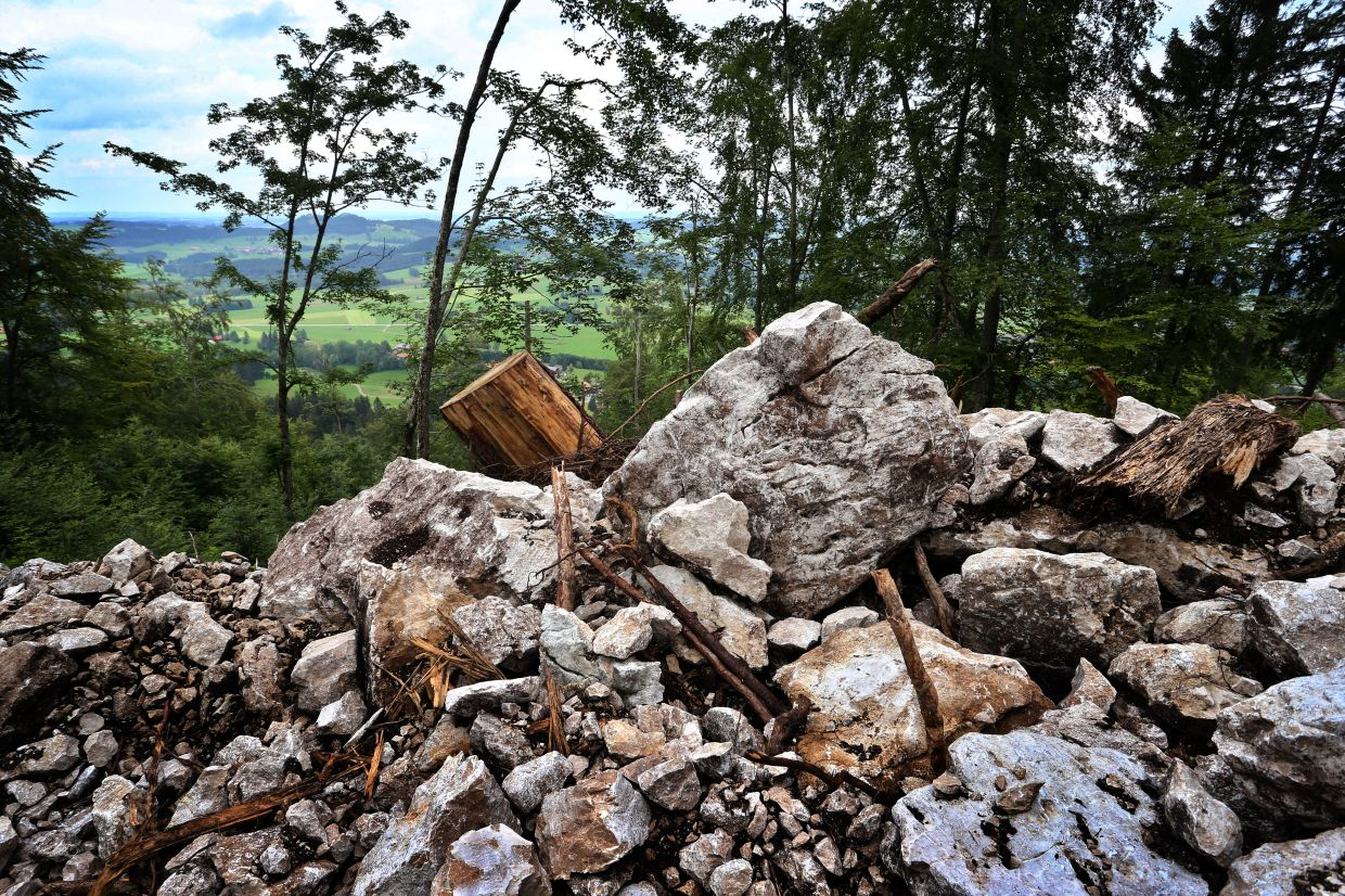 Rubble covers a slope in Bavaria where treasure hunters looking for rumoured Nazi gold dug up the earth with an excavator before running off.