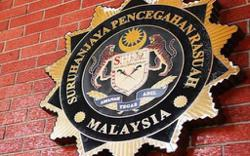 Ex-political aide slapped with six graft charges