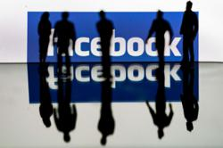 Facebook moves to cool hot talk on worker message board