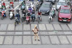 Vietnam says tropical storm weakening, but risk of heavy rain