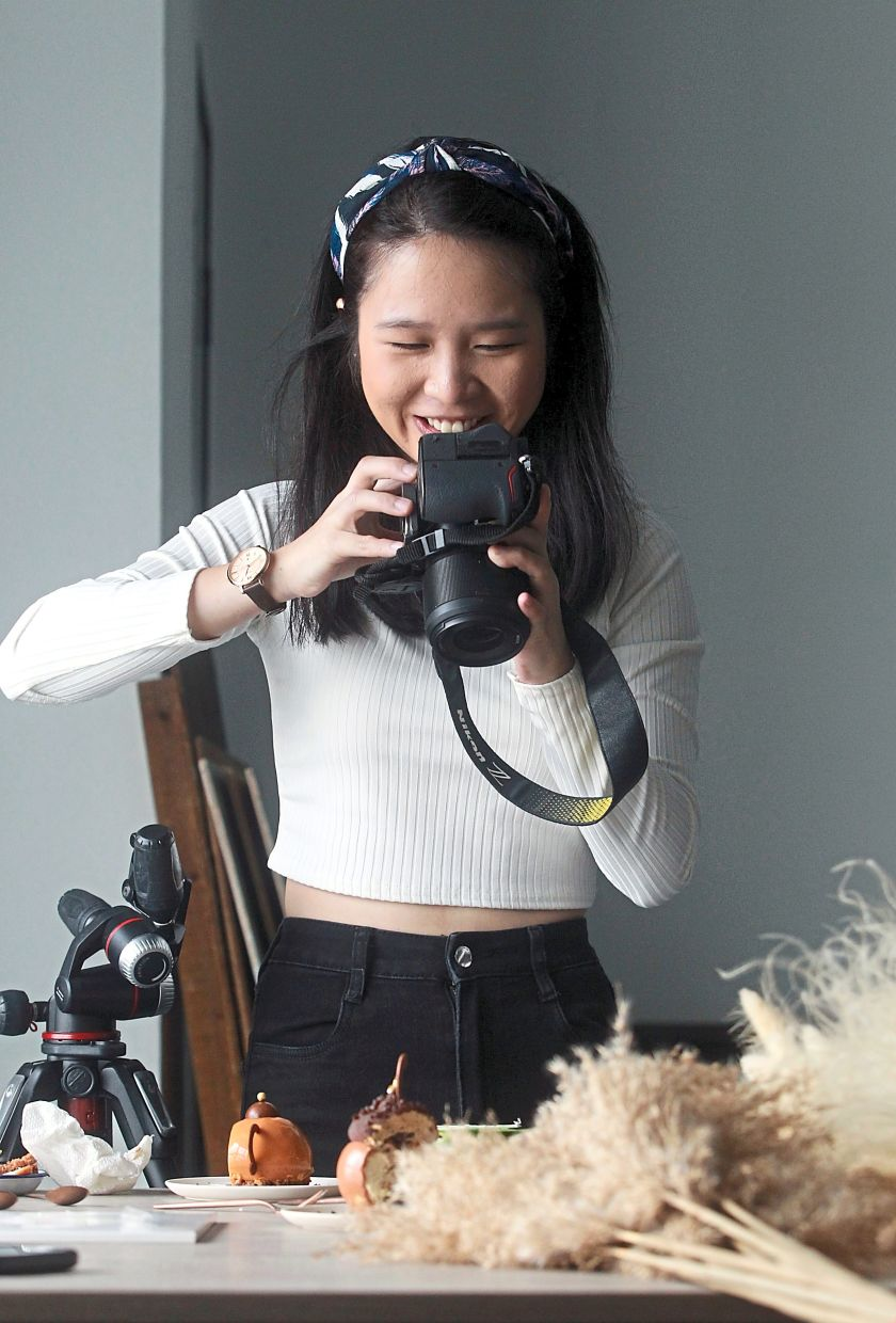 Lim is training her assistant to be a food stylist so that she can focus on photography and they can work as a team. — ART CHEN/The Star