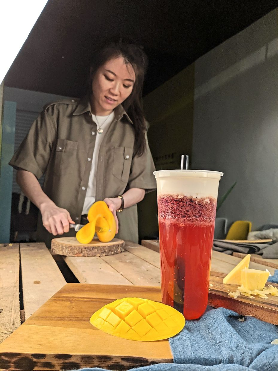 Cooking is a skill food stylists like Goh (pictured here) have to master, as sometimes they are required to prepare and plate meals for photo shoots. — GOH SOO YIN