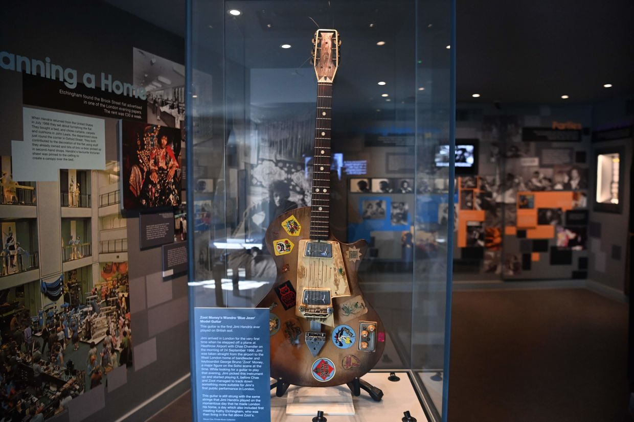 A picture shows British musician Zoot Money's Wandre 'Blue Jean' model guitar, the first guitar Jimi Hendrix played in Britain, on display inside the Hendrix Flat. Photo: AFP
