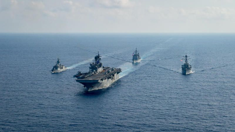 Royal Australian Navy guided-missile frigate HMAS Parramatta (FFH 154) (left) sails with US Navy Amphibious assault ship USS Americ, Ticonderoga-class guided-missile cruiser USS Bunker Hill (CG 52) and Arleigh-Burke class guided missile destroyer USS Barry (DDG 52) in the South China Sea, on April 18, 2020. - Reuters