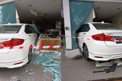 Staff accidentally crashes car into bank